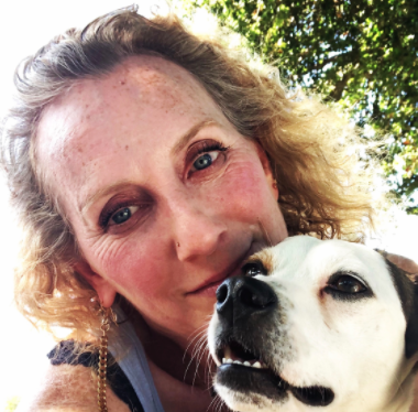Portrait of Board Member Lori with dog