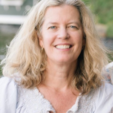 portrait of Board Member Megan smiling