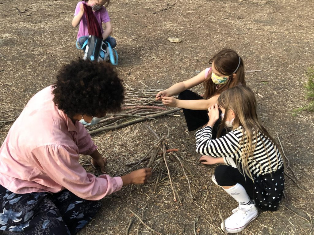 Photo of youth building a fire