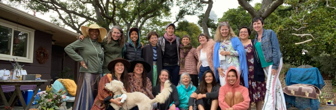 Photo of gaia passages staff with trees in background